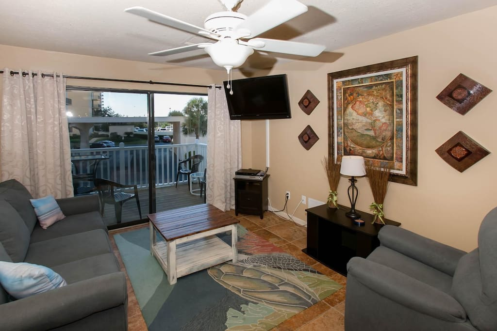 Living room with ceiling fan and 47-inch TV/DVD
