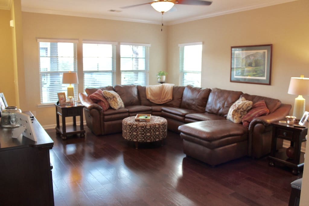 Large open living room with sectional to accommodate a crowd!