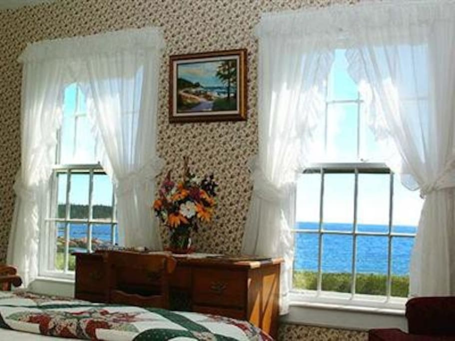 Room 2 at Acadia's Oceanside Meadows Inn looks directly over the beach and crashing surf and offers a queen sized bed and private bathroom.