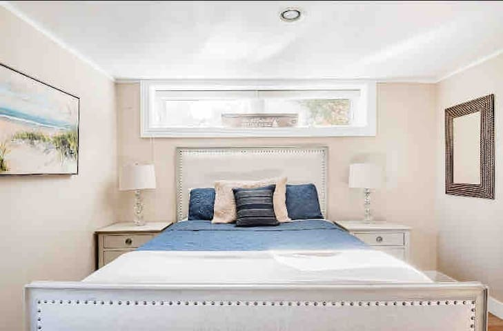 Sleep comfortably in this beautifully decorated bedroom featuring a queen sized bed and closet.