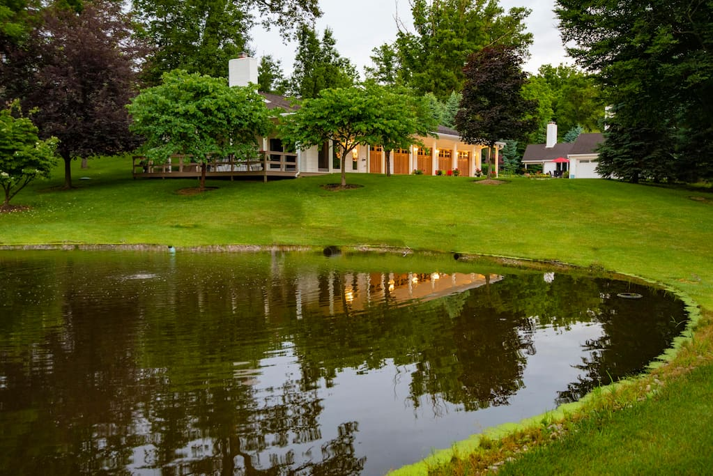 The Guesthouse overlooks a scenic pond.