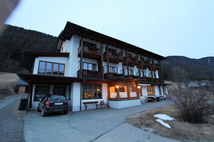 Apartment at walking distance from the Weissensee, with a private beach pool and lawn