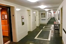 Elevator at third-floor, room down the hall to the right
