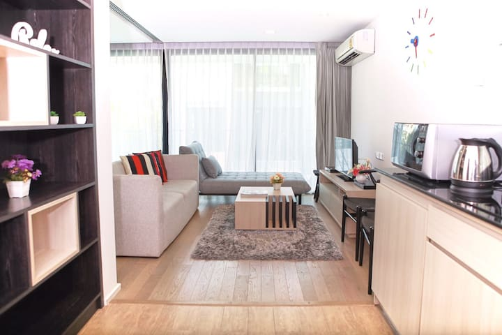 Living room with sofa bed to accommodate another guest and to enjoy your relaxing time in the room.