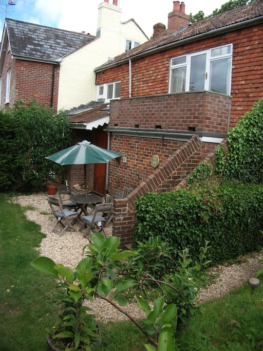 Access via rear of property, private garden and seating area