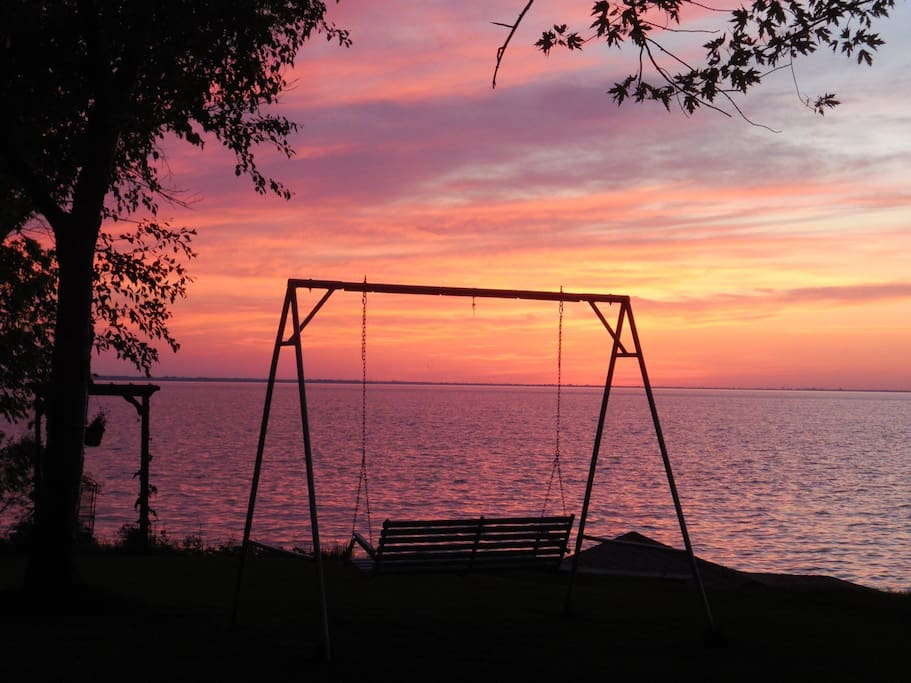 swing bench at sunset