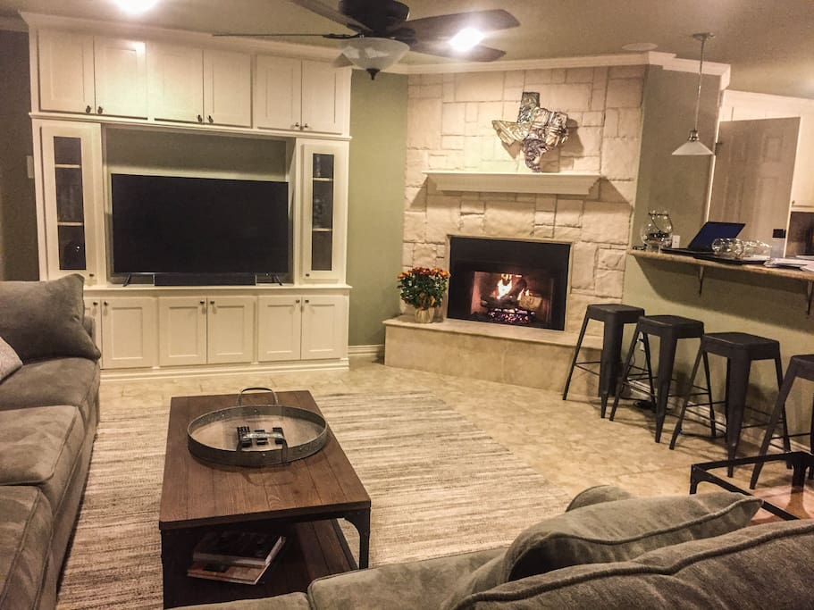 Living room complete with Smart TV, gas fireplace, and plenty of seating even for large groups