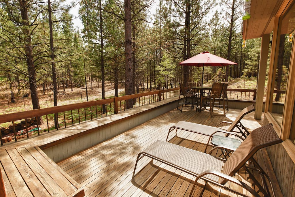 Off the kitchen and living room, the expansive deck has lots of seating.