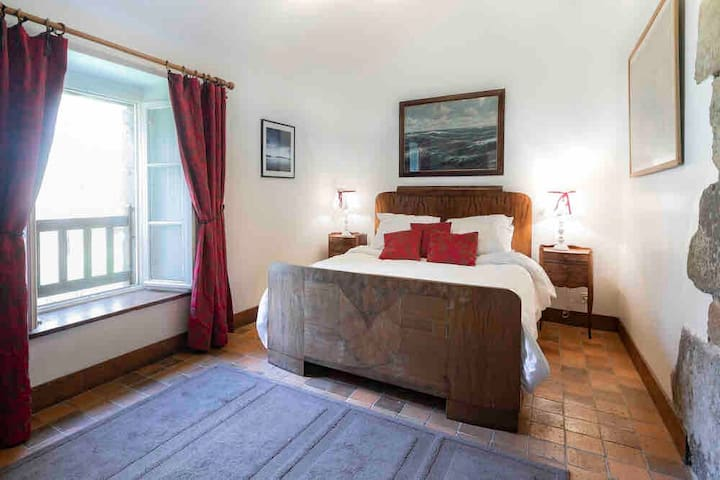 Room 1 - main level bedroom with double bed.