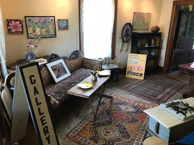 Relax in the front parlor surrounded by works of art by local artists.