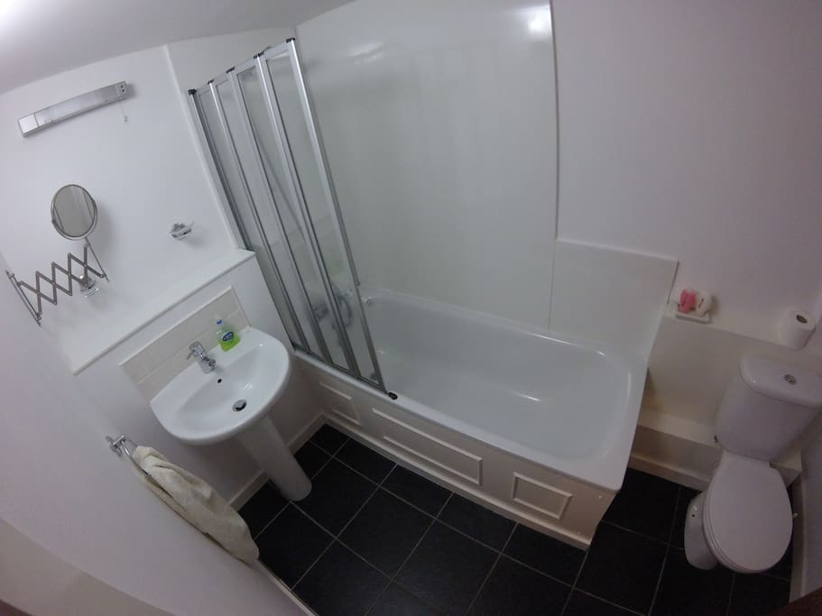 Downstairs bathroom with full bath and overhead shower