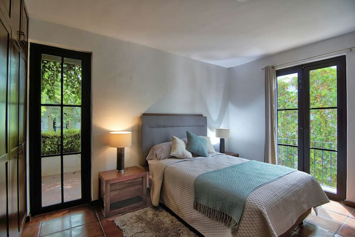 Second floor bedroom with queen size bed and private balcony