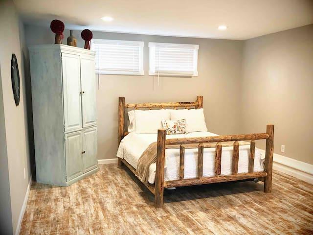 Custom made Northwest log bed with comfortable memory foam mattress