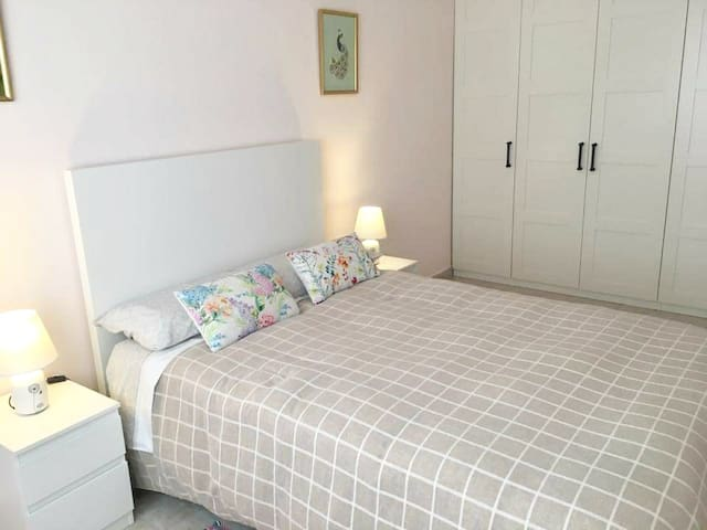 Modern, spacious and bright room with comfortable double bed.