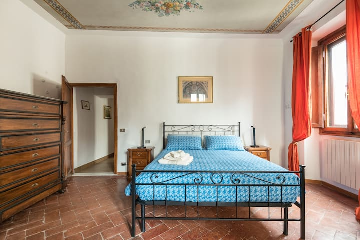Master bedroom with original cotto floors, fresco ceiling and antique furniture