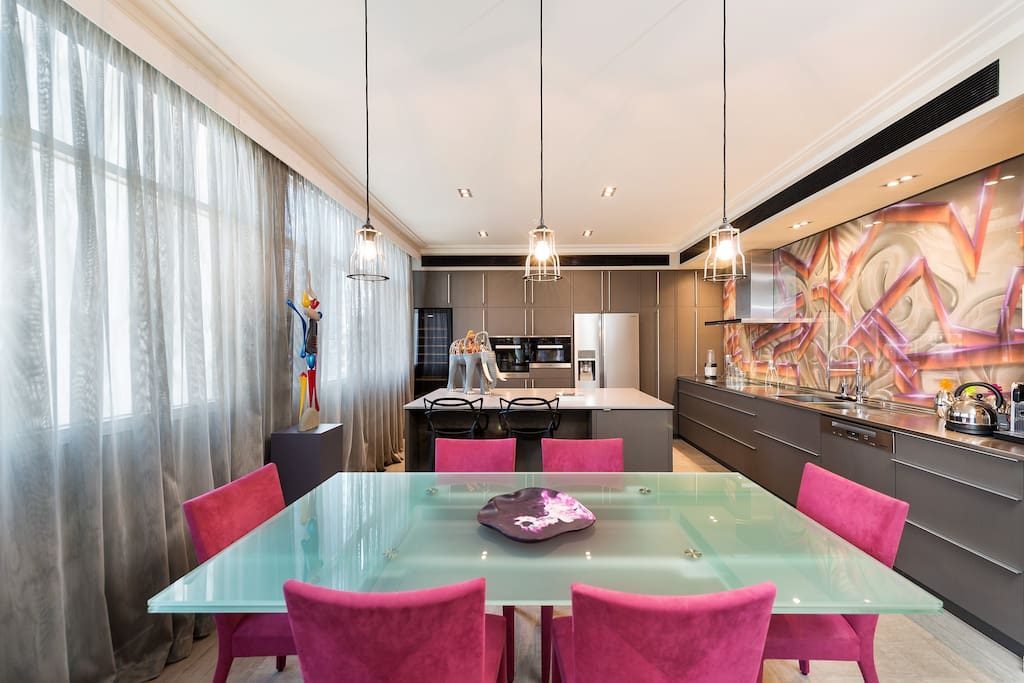 Overly generous One bedroom apartment with fully equipped gourmet kitchen, featuring a graffiti style splashback.