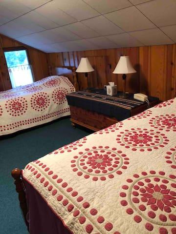 Second floor bedroom with twin beds.