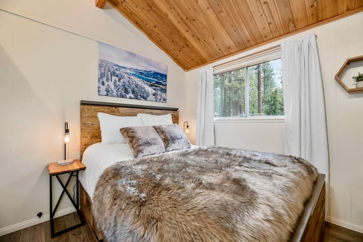 Guest bedroom features a Queen bed, 2 night stands with USB charging ports, lights on dimmers, high quality linens / bedding,  and a closet.