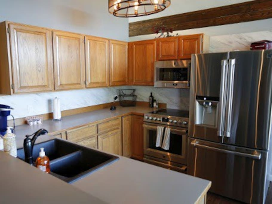 New top of the line Kitchen Appliances open to dinning room