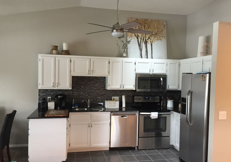 Stainless appliances. High ceiling with a sky light. Keurig & Nesspreso machines.