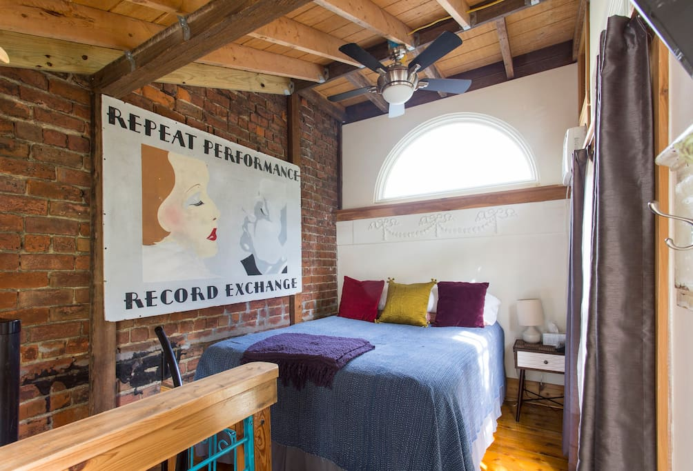 Upstairs loft with queen size bed and TV.