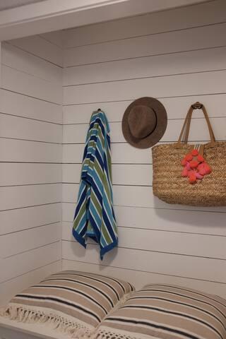 Beach storage with beach wagon, cooler, beach chairs, beach blanket.