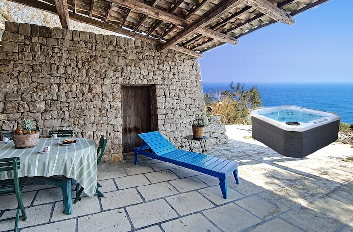 Sea access and heated outdoor whirlpool at stone villa
