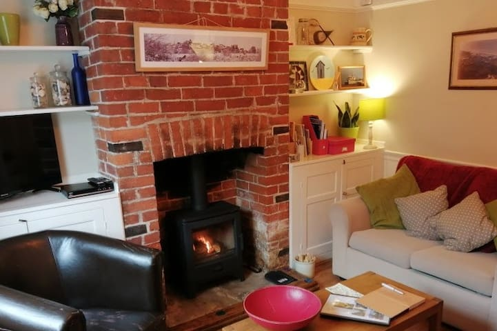 Cozy living room with log burning stove.