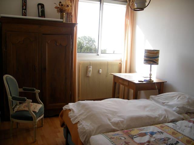 Chambre chez l'habitant.