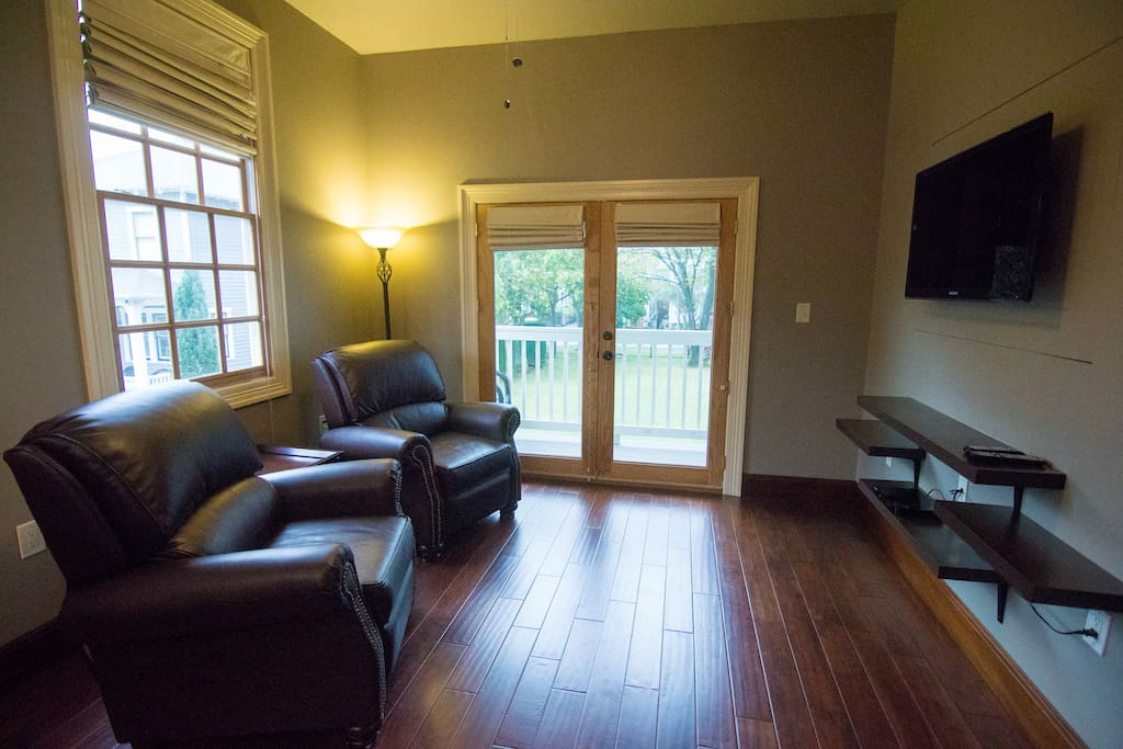Teak Floors in the main living area with carpeted bedrooms.