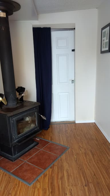 Front entrance has a woodstove