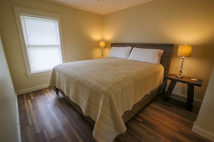 """""""They thought of all the comforts you might want."""" From a guest review PHOTO: King size master bed"""