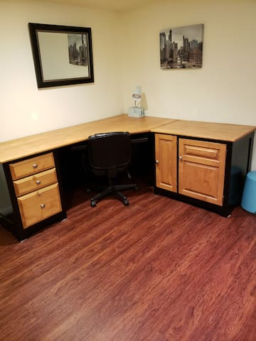Large corner desk and adjustable office chair for travelers conducting business or just looking for a nice place to write postcards.