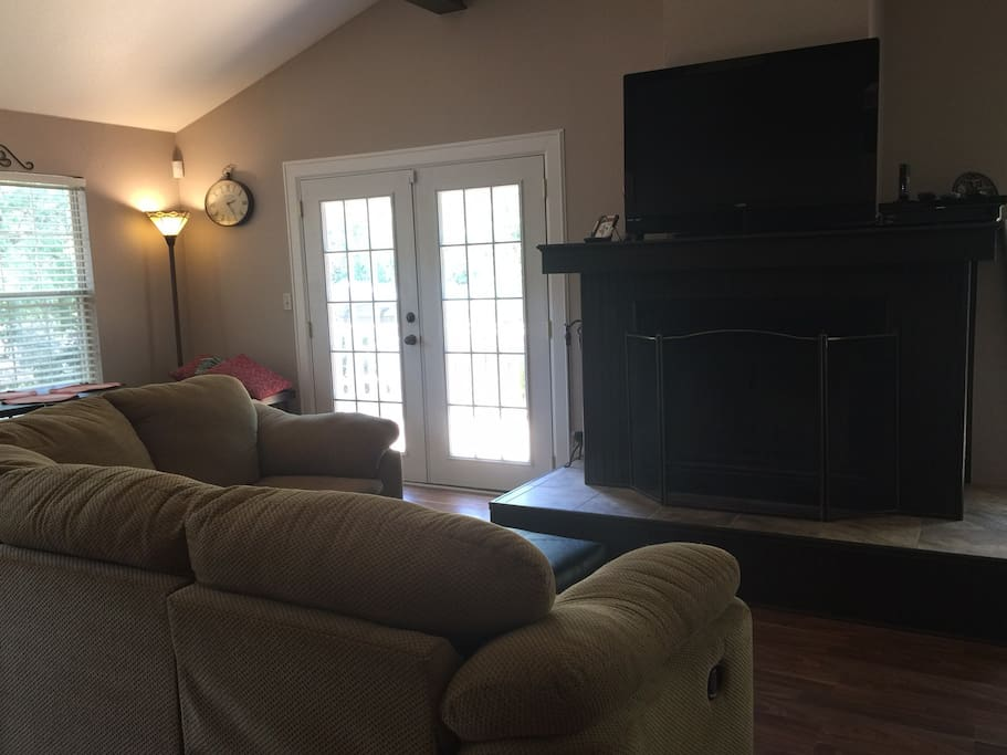 Larhe open family room, wood floors, vaulted ceilings.  TV with DISH TV  Atrium doors open to large multi level deck.