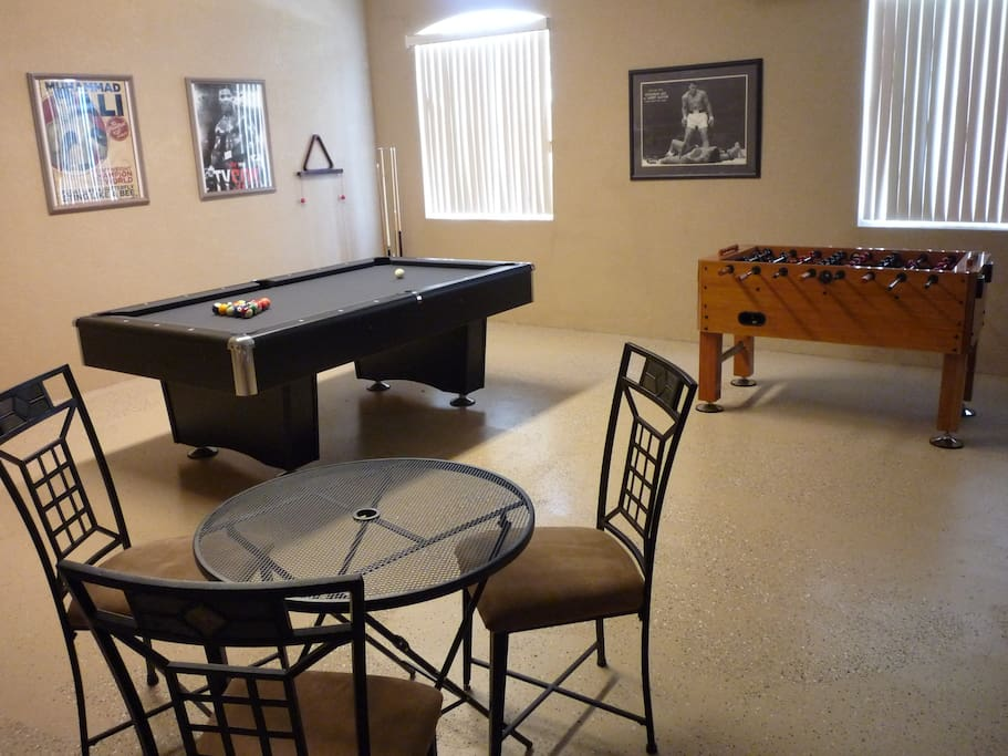 Games Room with 7ft x 3 1/2 ft slate pool table and foosball