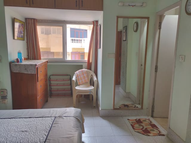 Side view of bedroom with an attached bathroom.