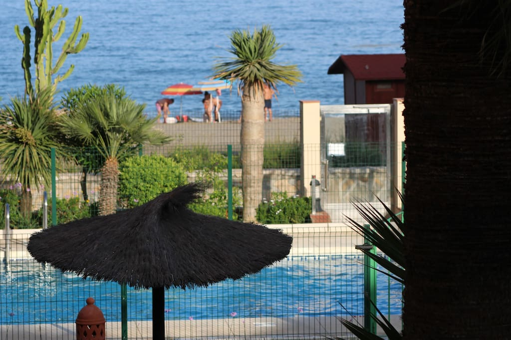 communal pool with direct access to beach