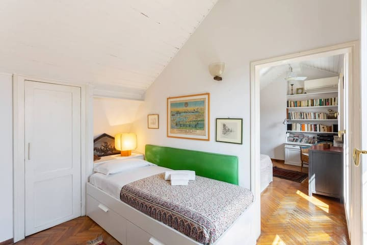 The Bedroom - The comfortable single bed with soft bed- linen and towels