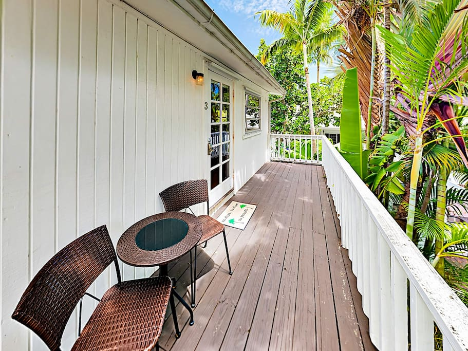Relax on the thoroughly Floridian shaded porch at the 2-person bistro table.