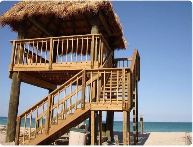 Amazing Tiki Hut!!!  Has Table with bench and top floor has seating area.   Just walking out of the gate, we have a shower for your convenience. We also provide beach chairs, umbrellas, and Beach Towels!!