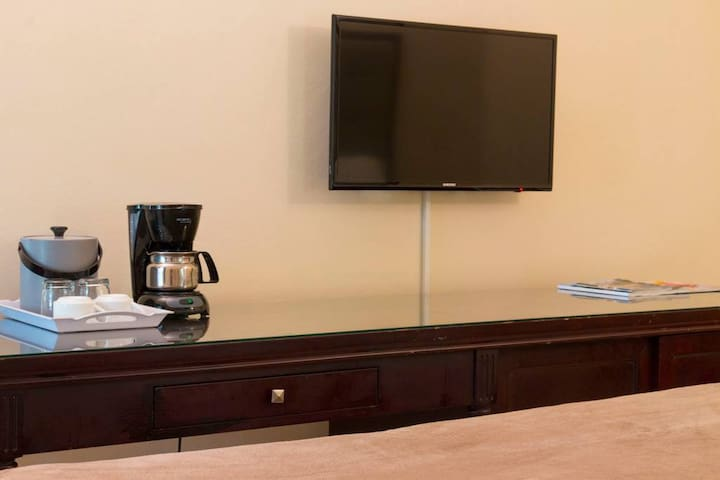 """Your room features a 40"""" LED TV, coffeemaker, ice bucket and a mini refrigerator. Complimentary coffee is provided each day with housekeeping services."""