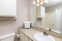 2nd bathroom with private access.  Full size bathtub with shower and ample counter space.