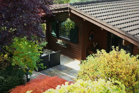 Berliner holiday house in green garden with pool.
