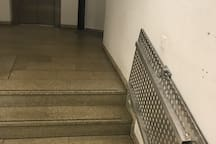 Accessibility ramp at the entrance hall before elevator.