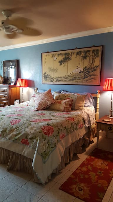 Large king size bed, closet, dressers, make-up or grooming table, sitting chair, mirror, enclosed TV inside cabinet. Luxurious and romantic.