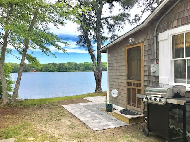View of the side entrance of Sunchaser Cottage. Enjoy grilling on the large gas grill.