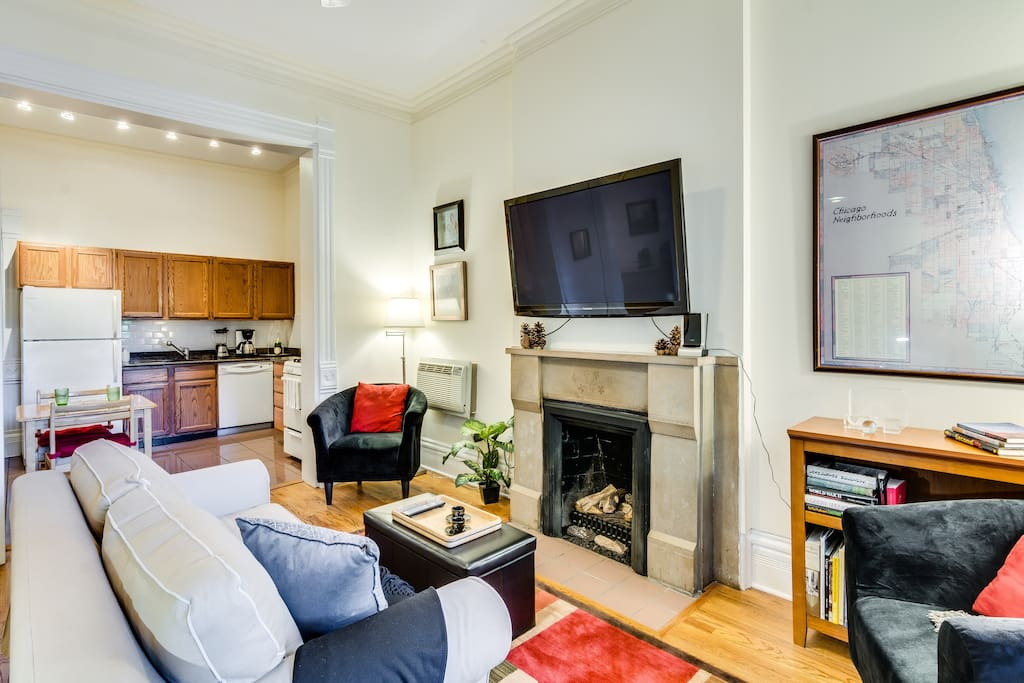 The living room is open to the kitchen, and there are high ceilings throughout.