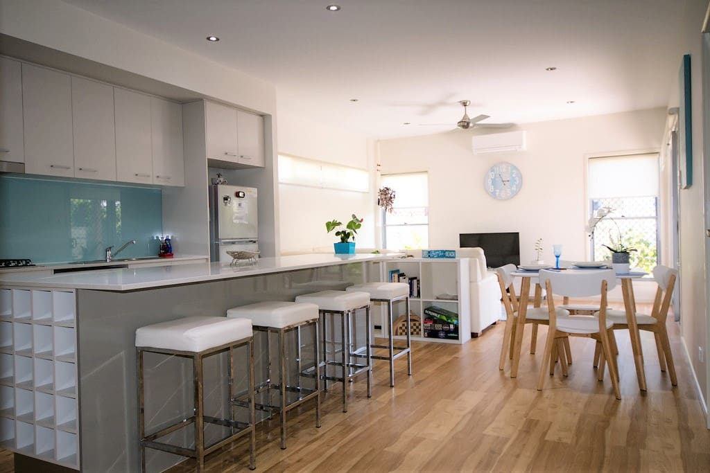 Fully equipped kitchen featuring a full length breakfast bar