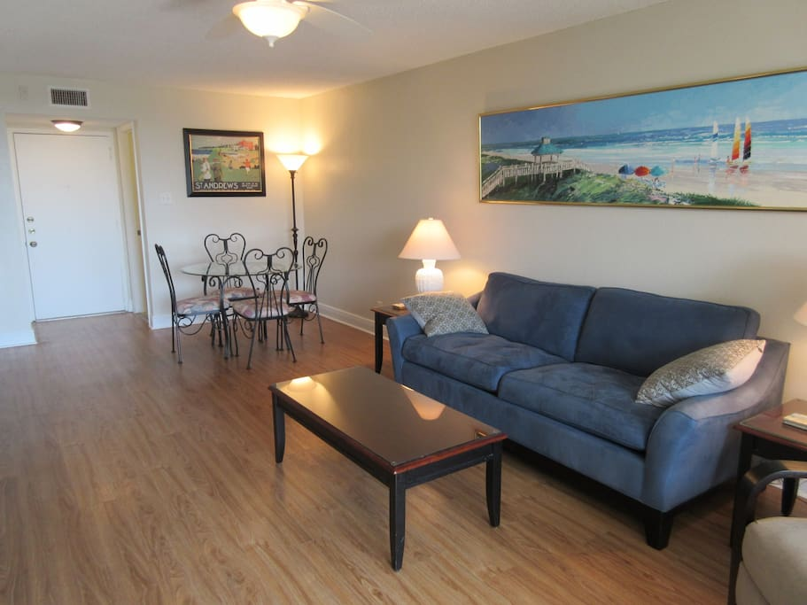 Living Room with Queen sleeper sofa.  Dinette Area