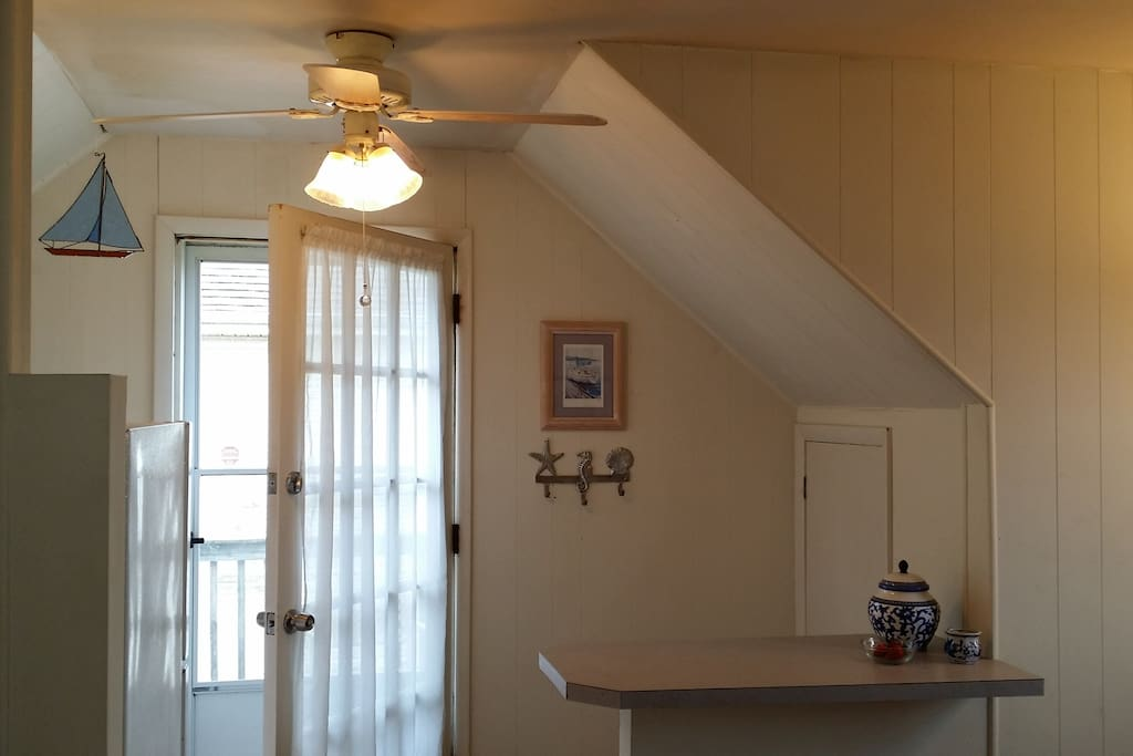 The dining counter with two stools is across from the kitchen.   Next to the door you'll find to borrow:  a beach bag with 2 beach tags, towels and a sand mat. Two beach chairs are in the closet along with grill utensils.